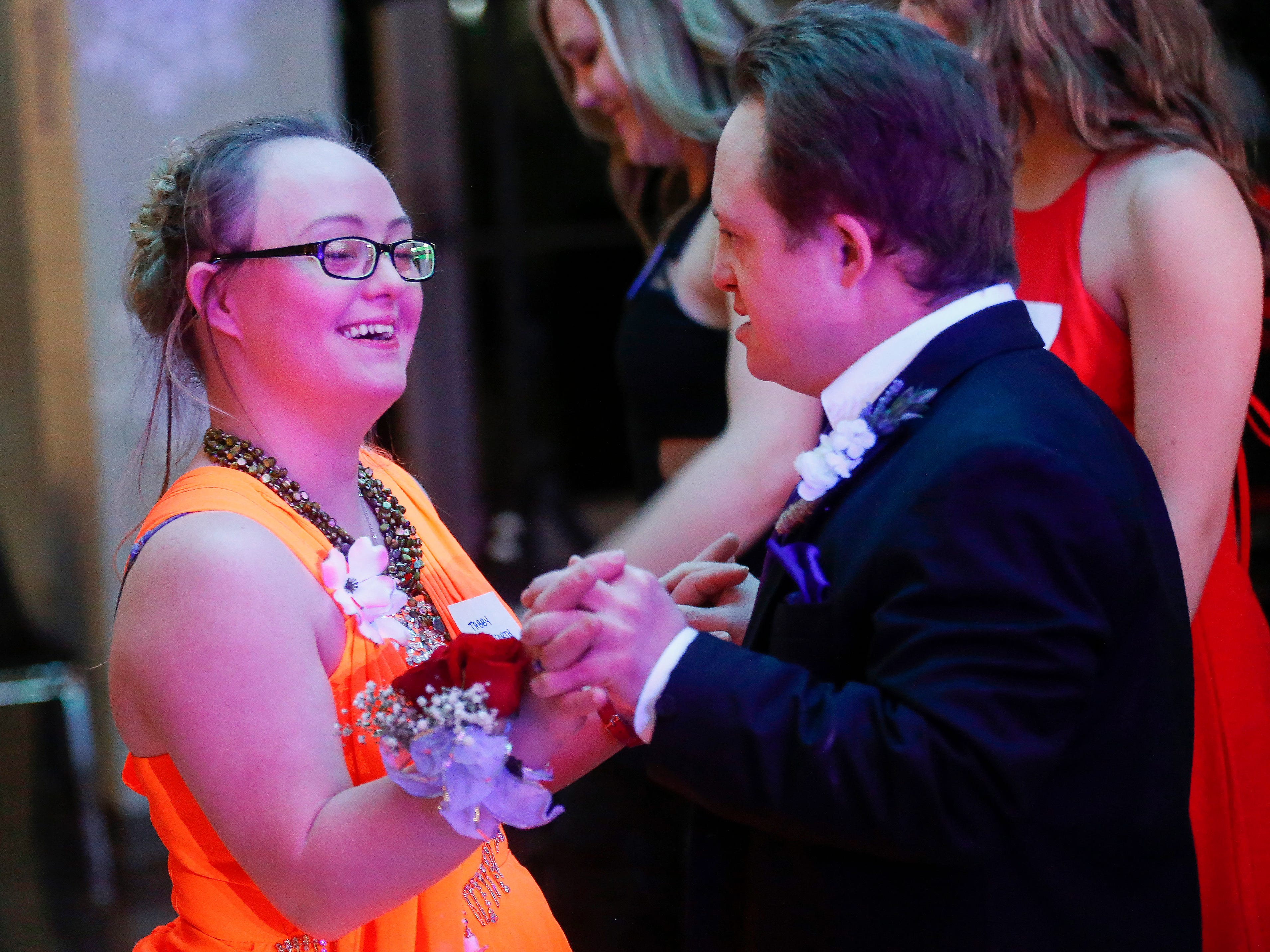 Tabby Hedgecorth and Nick Watterson share a dance during the Camp Barnabas Snow Ball at Springfield Catholic High School on Saturday, Jan. 26, 2019.