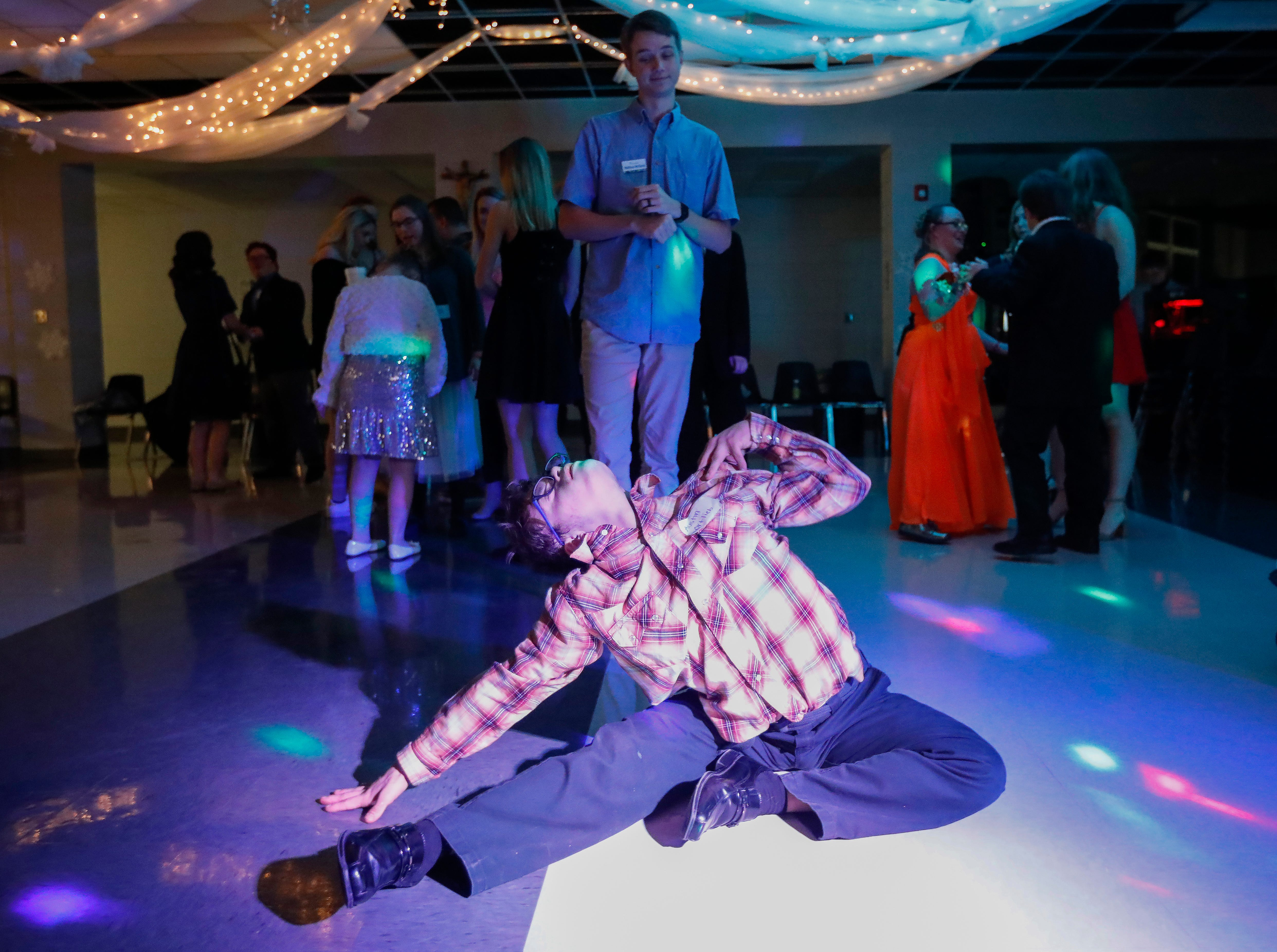 Austin Ortlieb shows off his dance moves during the Camp Barnabas Snow Ball at Springfield Catholic High School on Saturday, Jan. 26, 2019.