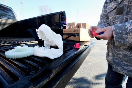 Val Glessner displays some of his 3-D-printed items.