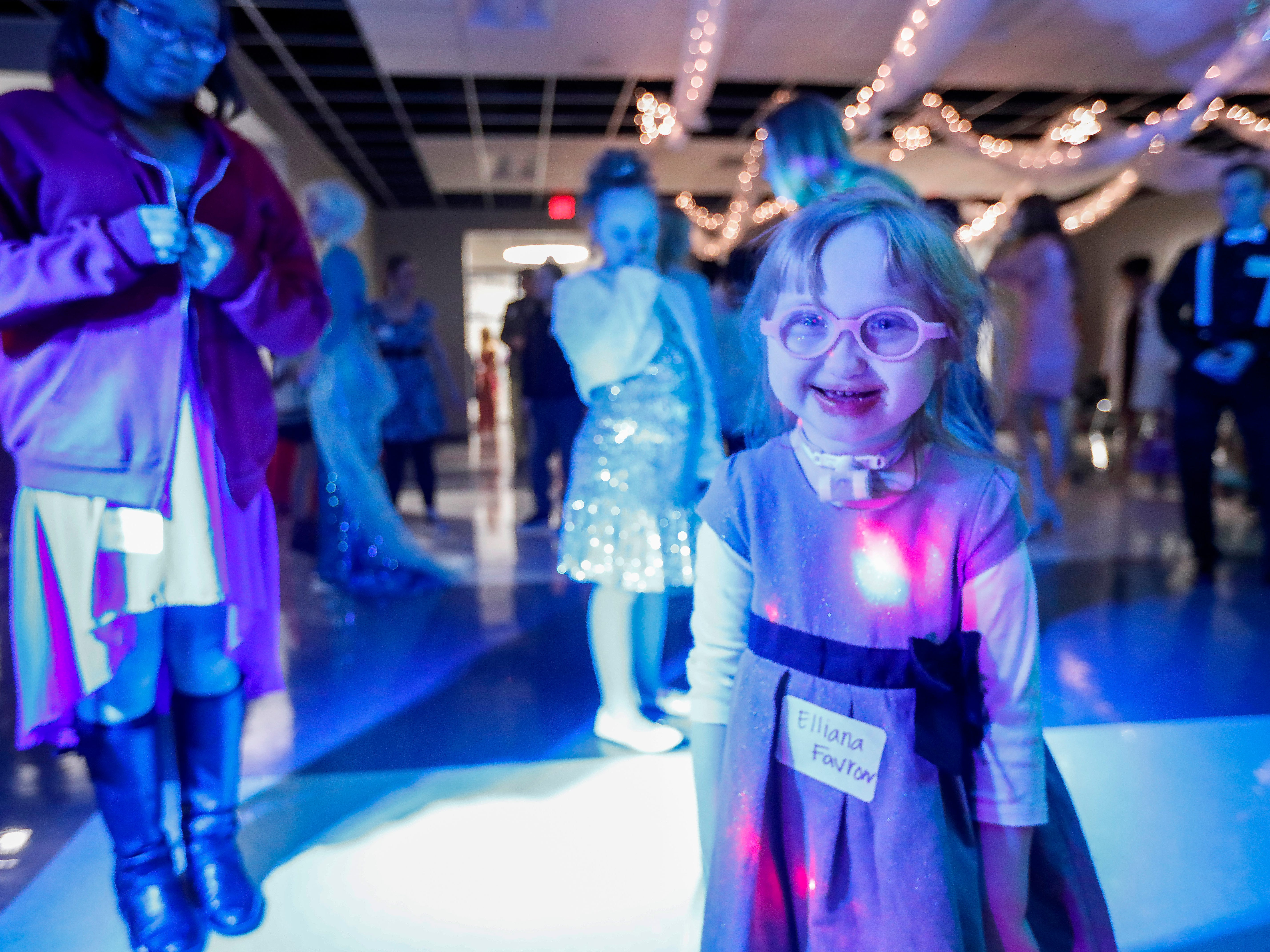 Elliana Favron smiles while dancing during the Camp Barnabas Snow Ball at Springfield Catholic High School on Saturday, Jan. 26, 2019.
