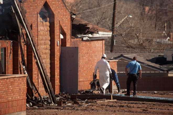 Authorities investigate the scene of the LDS stake center fire Saturday, Jan. 6, 2019.