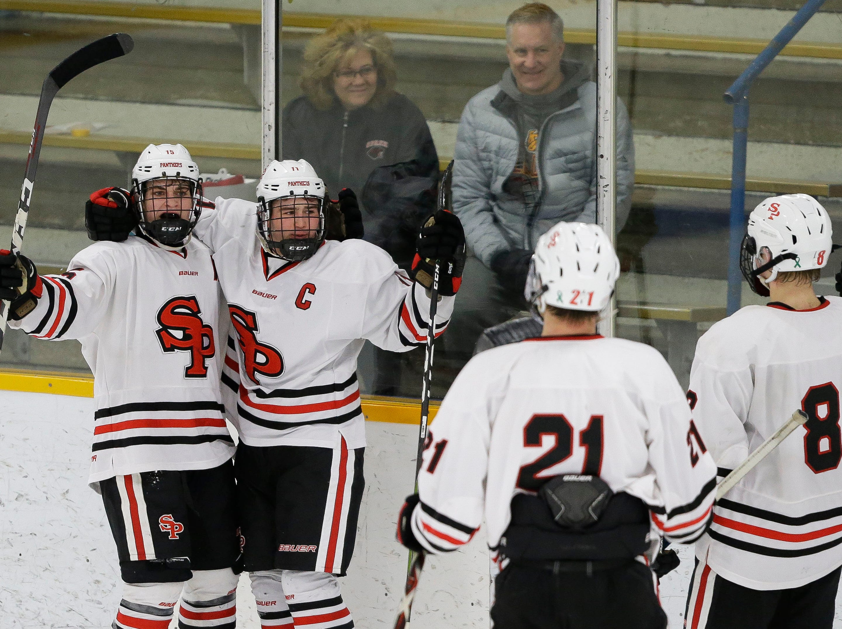 SPASH's Barrett Brooks (11) celebrates after scoring an empty-net goal on Saturday, January 26, 2019, at K.B. Willett Ice Arena in Stevens Point, Wis. Brooks tallied a hat trick to lead the Panthers to a 5-3 victory.Tork Mason/USA TODAY NETWORK-Wisconsin