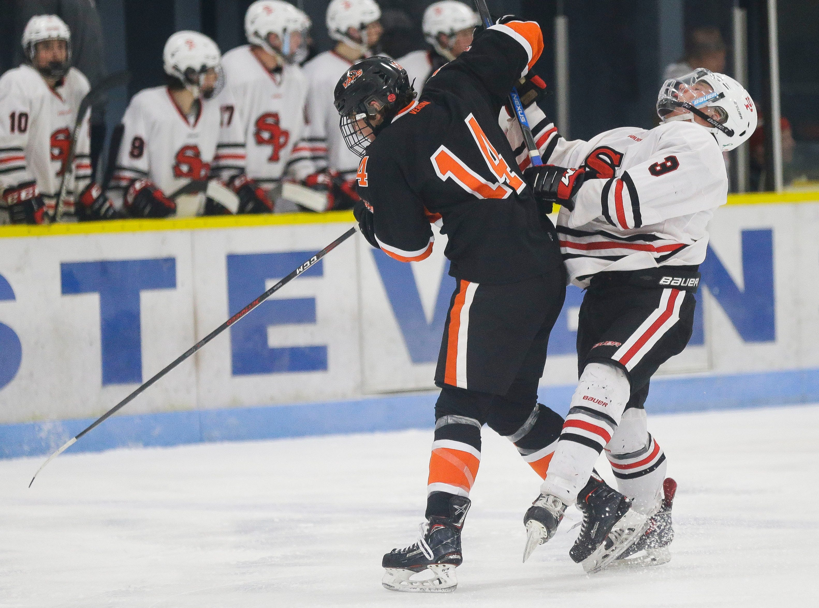 SPASH's Brady Dillingham (3) is checked by Verona's Jake Osiecki (14) on Saturday, January 26, 2019, at K.B. Willett Ice Arena in Stevens Point, Wis. Tork Mason/USA TODAY NETWORK-Wisconsin