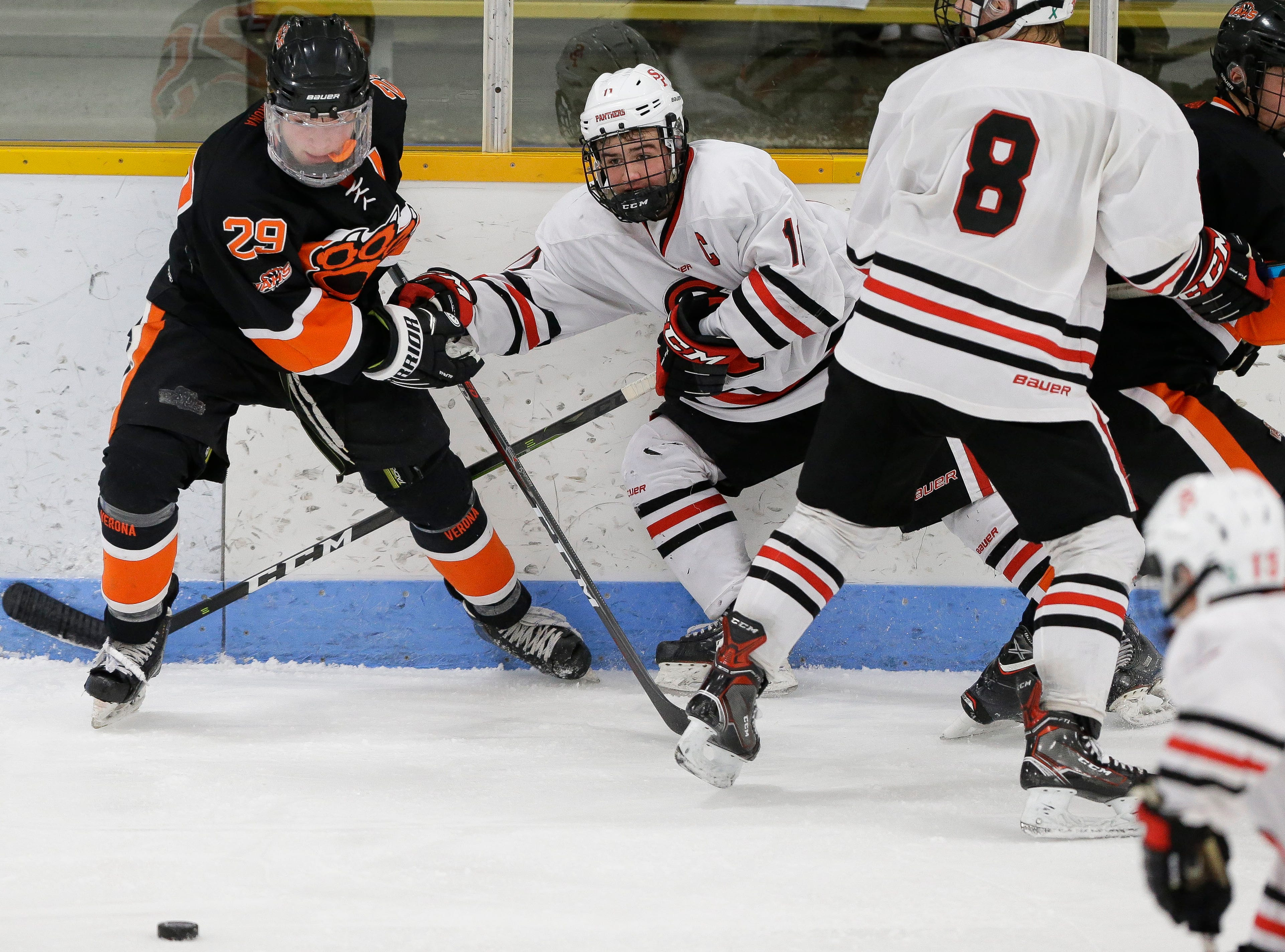 Verona's Mack Keryluk (29) passes the puck out of a scrum along the boards against SPASH on Saturday, January 26, 2019, at K.B. Willett Ice Arena in Stevens Point, Wis. Tork Mason/USA TODAY NETWORK-Wisconsin