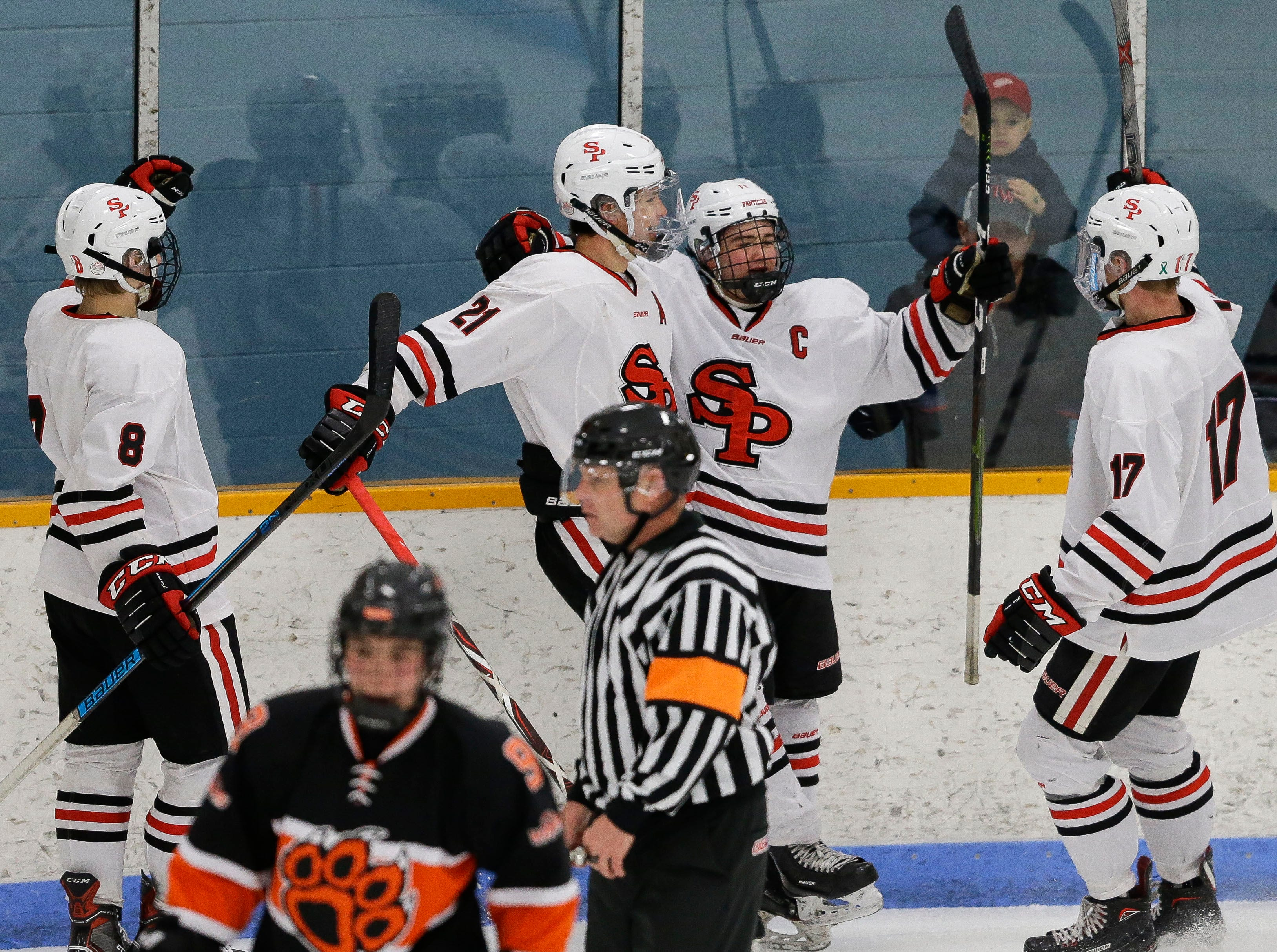 SPASH's Barrett Brooks (11) celebrates with his teammates after scoring a goal against Verona on Saturday, January 26, 2019, at K.B. Willett Ice Arena in Stevens Point, Wis. Brooks had a pair of first period goals to give the Panthers a 2-1 lead at the first intermission.Tork Mason/USA TODAY NETWORK-Wisconsin