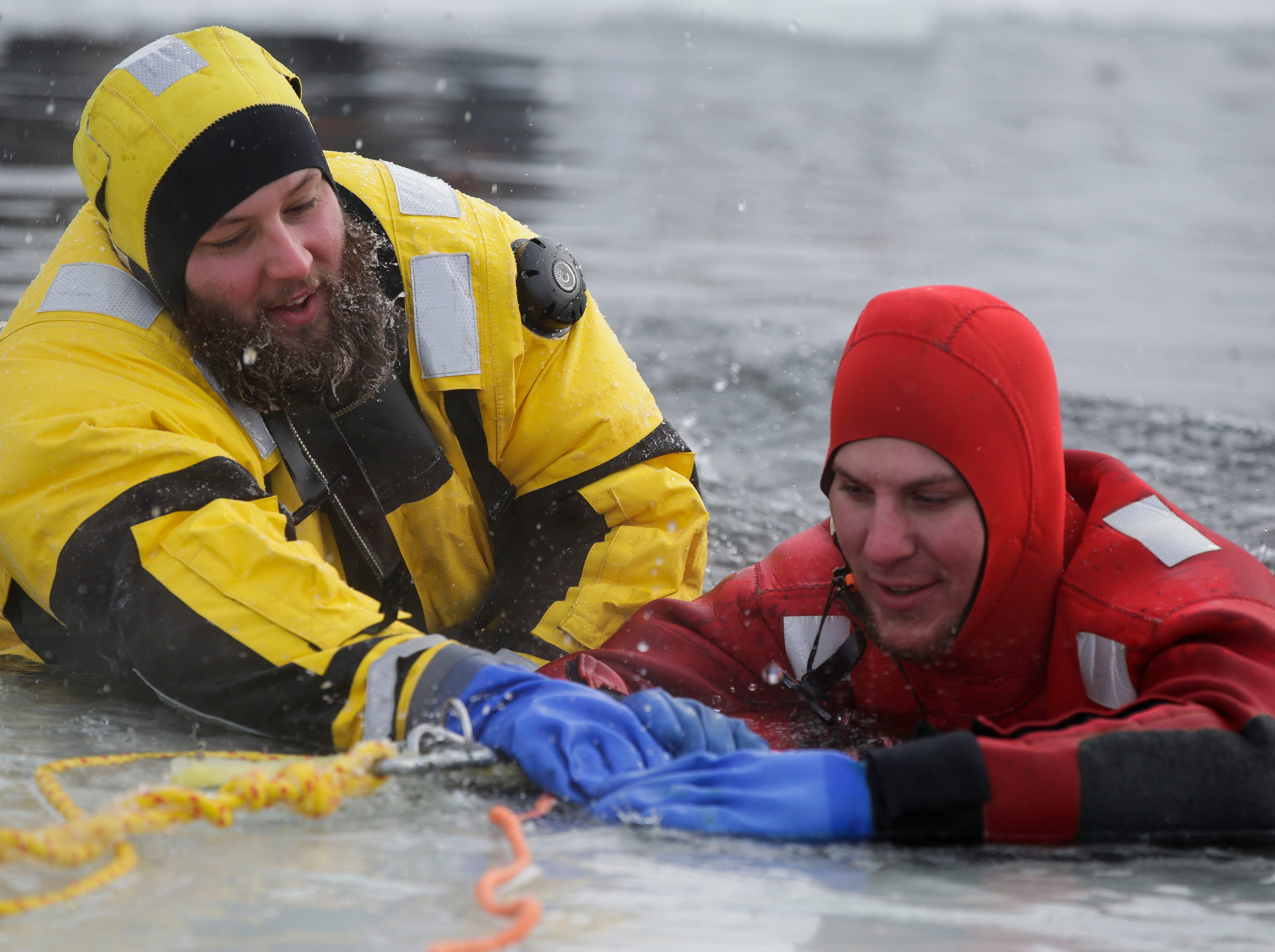 Firefighters from various departments participate in an ice rescue training session on Saturday, January 26, 2019, outside Pittsville, Wis. The Pittsville Fire Department provides the training annually for other departments across the state to help ensure as many departments as possible have trained personnel.  Tork Mason/USA TODAY NETWORK-Wisconsin