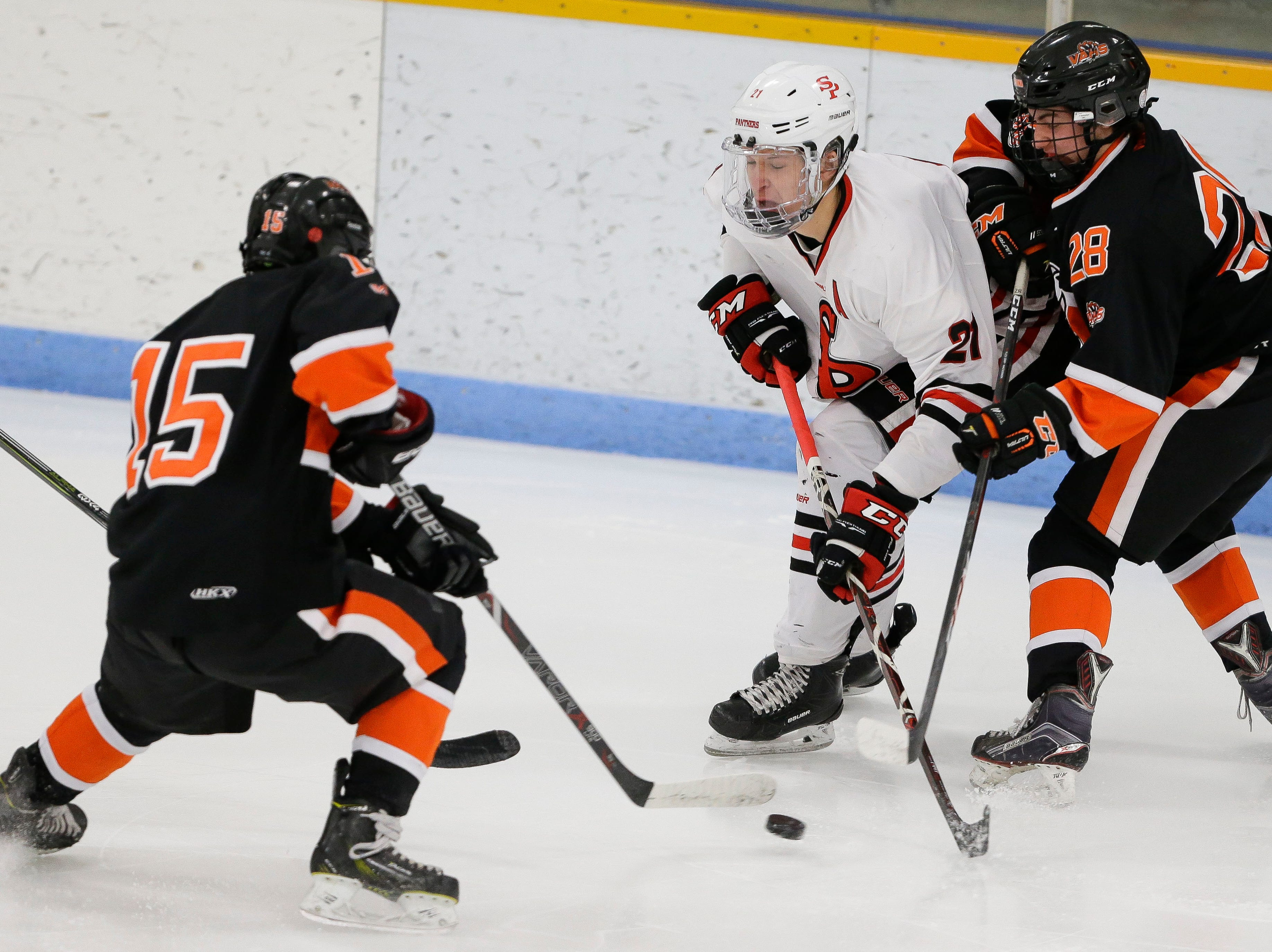 SPASH's Jake Minch (21) loses the puck to Verona's Michael Fischer (15) on Saturday, January 26, 2019, at K.B. Willett Ice Arena in Stevens Point, Wis. Tork Mason/USA TODAY NETWORK-Wisconsin