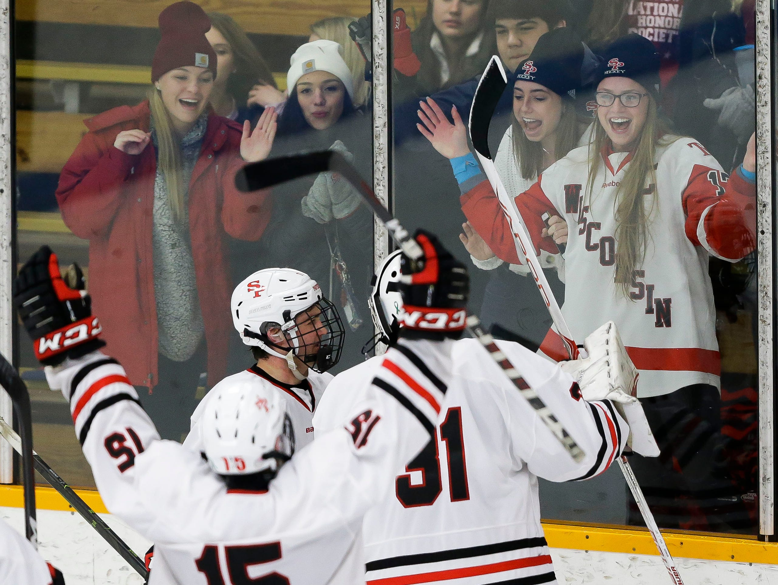 SPASH players celebrate with the Panthers student section on Saturday, January 26, 2019, at K.B. Willett Ice Arena in Stevens Point, Wis. The Panthers knocked off No. 2 Verona, 5-3.Tork Mason/USA TODAY NETWORK-Wisconsin
