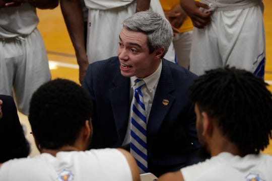 Tallahassee Community College men's basketball head coach Zach Settembre talks with his team during a timeout versus Chipola College Saturday, Jan. 26, 2019.