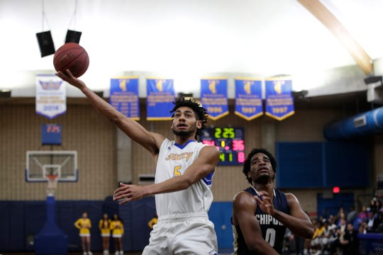 Tallahassee Community College's Deven Palmer (5) puts up a shot during a game between TCC and Chipola College Saturday, Jan. 26, 2019.