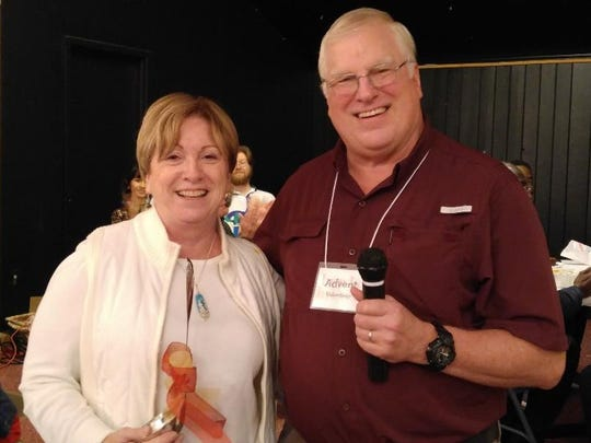 Best Chili - Marjie Smith and Emcee David Van Winkle, at the Holy Comforter Cookoff.