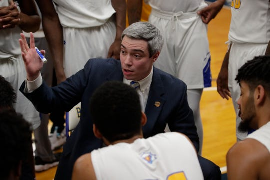 Tallahassee Community College interim men's basketball coach Zach Settembre talks with his team at a timeout during a game versus Chipola College Saturday, Jan. 26, 2019.