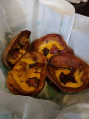 Downtown Crossing potato skins are Boston-style, fried light and crisp and loaded with cheese and bacon.