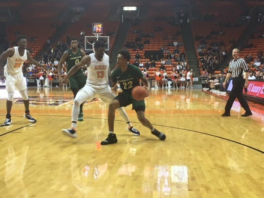 Charlotte's Brandon Younger works on UTEP's Ountae Campbell Saturday at the Don Haskins Center