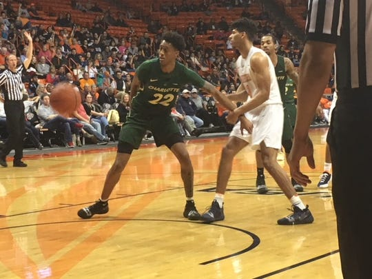 UTEP's Paul Thomas and Charlotte's Brandon Younger fight for a rebound Saturday night at the Don Haskins Center