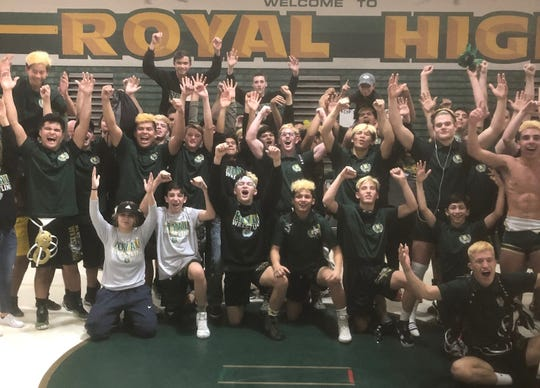 The Royal wrestling team celebrates after winning the CIF-Southern Section Division 4 Dual Meet Championships on Saturday night at Royal High.