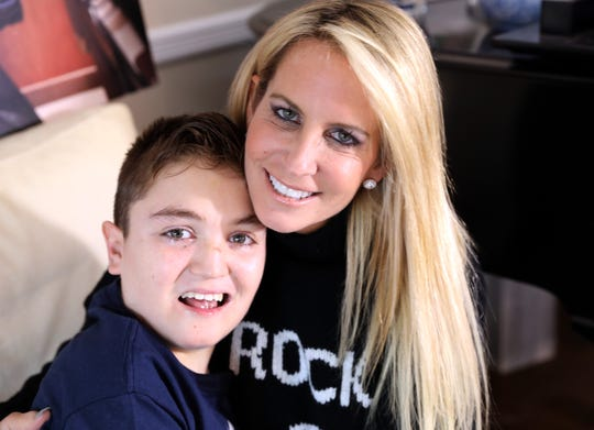 Robin Fiddle Posnack with her son Jack Posnack, 13, at home in New City Jan. 23, 2019. Jack has a rare genetic condition called familial dysautonomia that affects his autonomic nervous system. Jack plays video games and has found that the virtual world of gaming gives him a chance to connect with other kids and make friends.