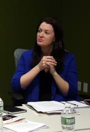 Mount Vernon spokeswoman Maria Donovan looks on as Mayor Richard Thomas meets with editors and reporters at the The Journal News/lohud offices in White Plains Nov. 6, 2017.