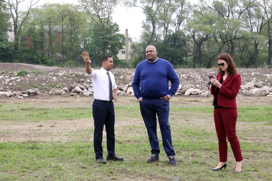 Mayor Richard Thomas speaks with Yonkers resident Terrence Brown as spokeswoman Maria Donovan stands by during the demolition of the grandstands at Memorial Field May 14, 2018 in Mount Vernon.