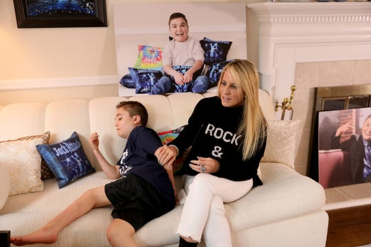 Robin Fiddle Posnack with her son Jack Posnack, 13, who has a rare genetic condition called familial dysautonomia that affects his autonomic nervous system, Jan. 23, 2019 at home in New City. Jack plays video games and has found that the virtual world of gaming gives him a chance to connect with other kids and make friends.