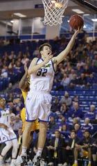 Delaware's Matt Veretto drives in the Blue Hens' 76-75 win at the Bob Carpenter Center Saturday.