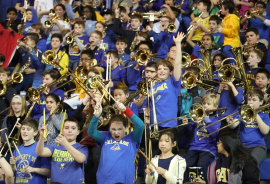 Potential future Hens perform alongside the Delaware Pep Band in the Blue Hens' 76-75 win at the Bob Carpenter Center Saturday.