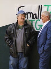 Longtime TRN sports writer and editor Andy Newberry chats with David Nix during Burkburnett's basketball game at Iowa Park on Friday night.