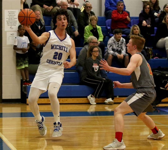 Wichita Christian's Evan Findley passes in the game against Christ Academy Friday, Jan. 25, 2019, at Wichita Christian.