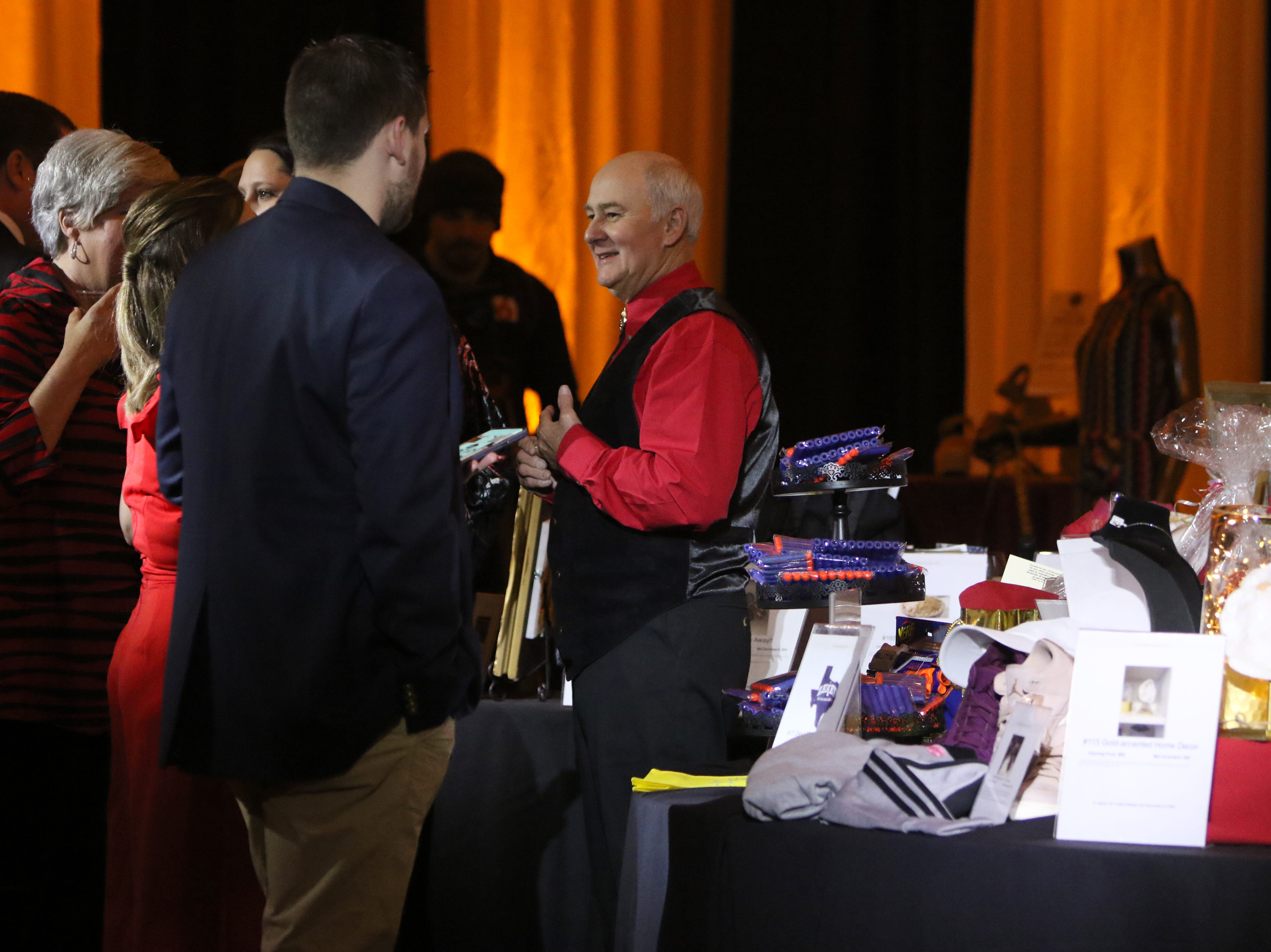 Many items were available for people to bid on at the silent aution at Christ Academy's 5th Annual Chocolate Soiree Friday, Jan. 25, 2019, at the Country Club.