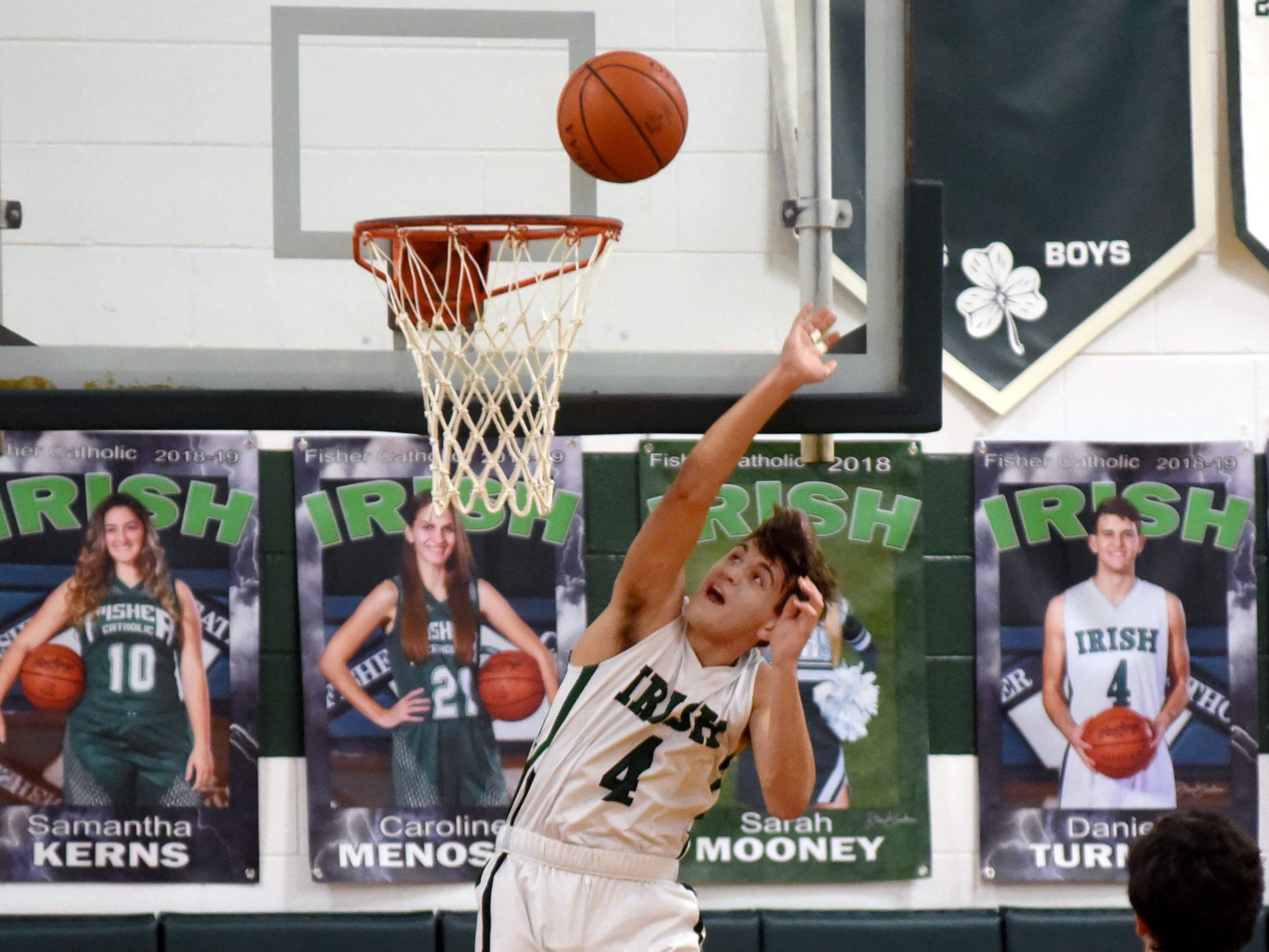 Fisher Catholic's Daniel Turner goes up for a layup against Rosecrans.