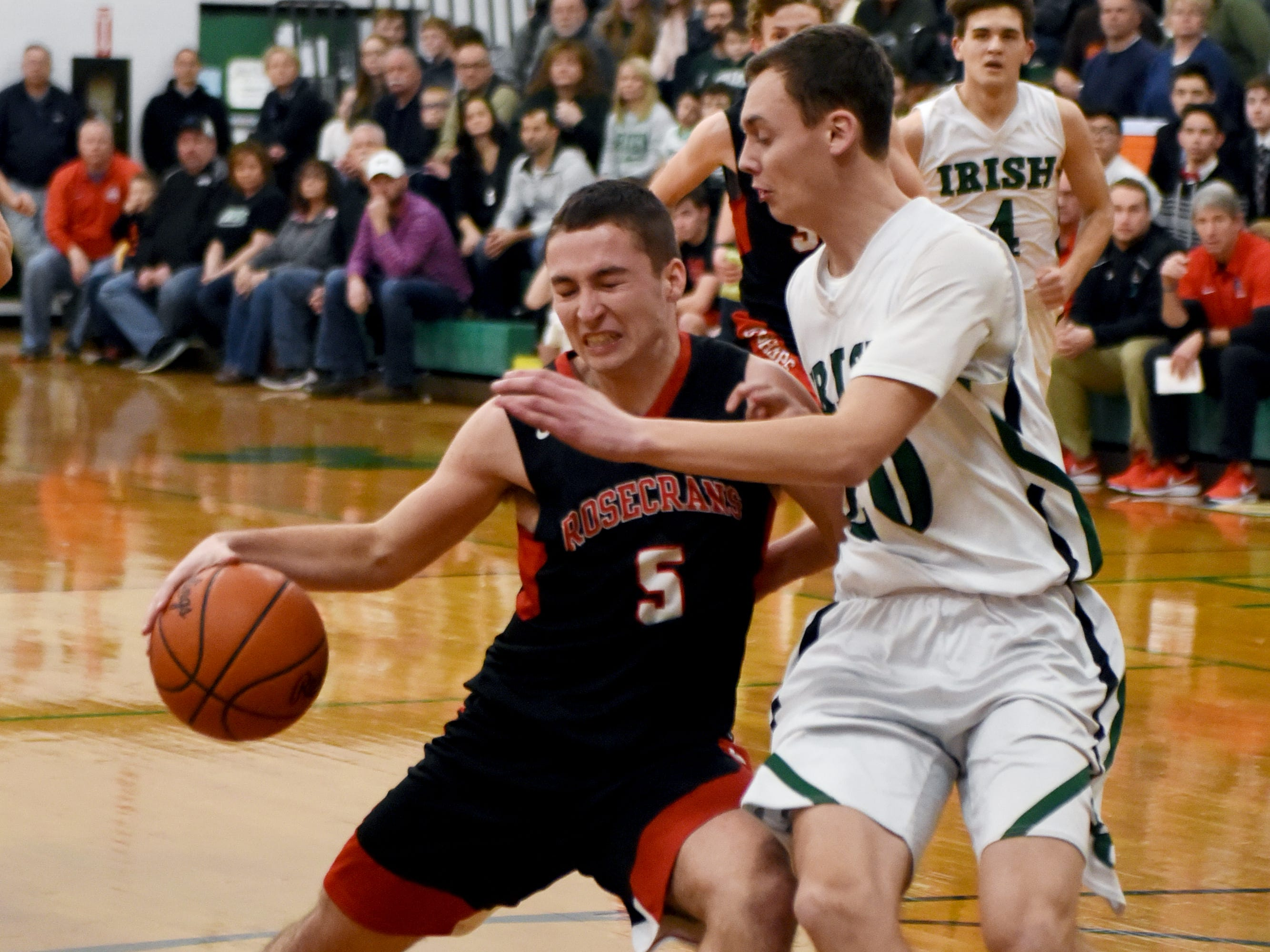Marcus Browning, of Rosecrans, drives into the lane against Fisher Catholic's Bryson Vogel.
