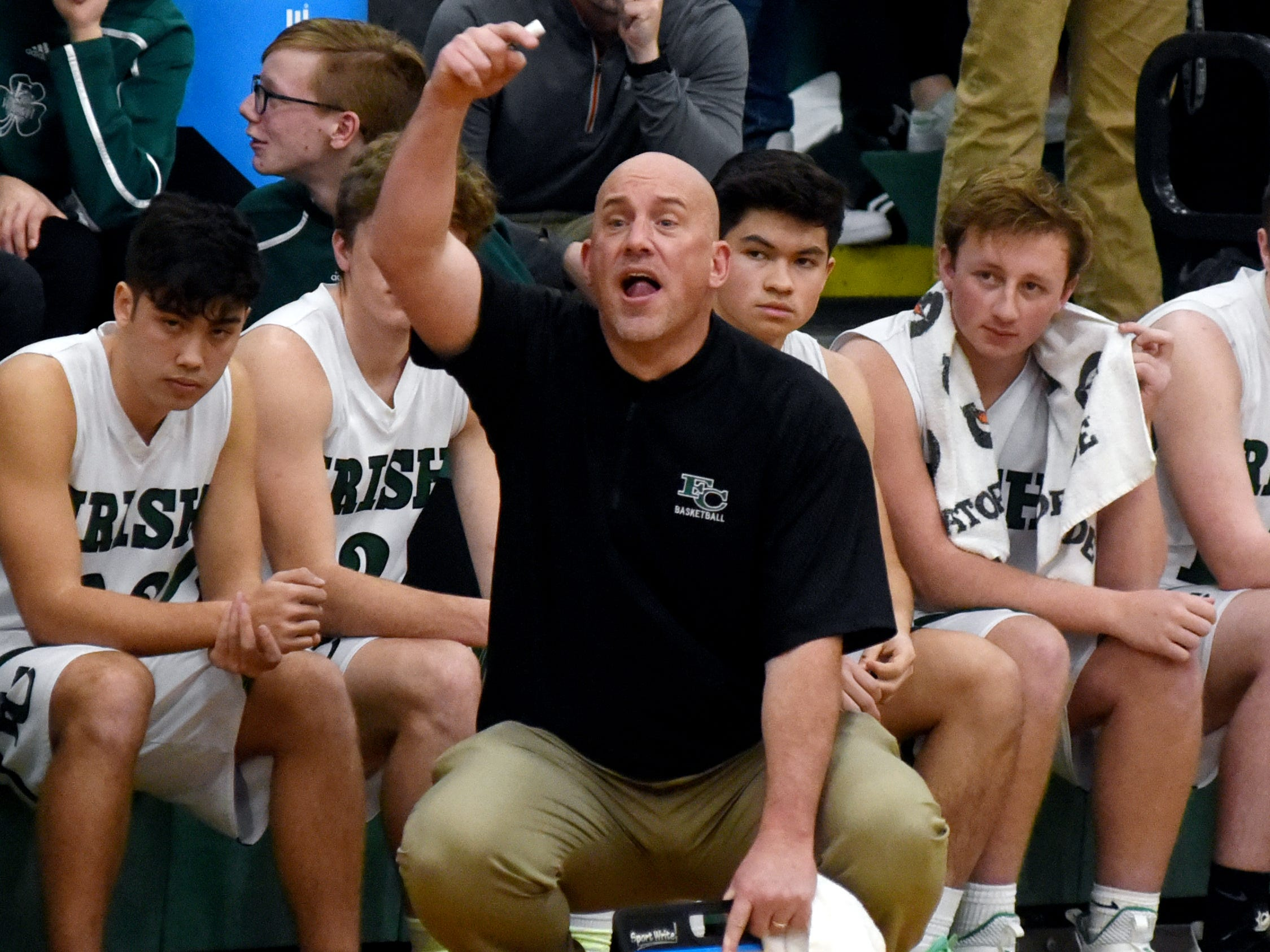 Fisher Catholic coach Shawn Brown gives signals to his team during the second half of a 55-47 loss to Rosecrans.