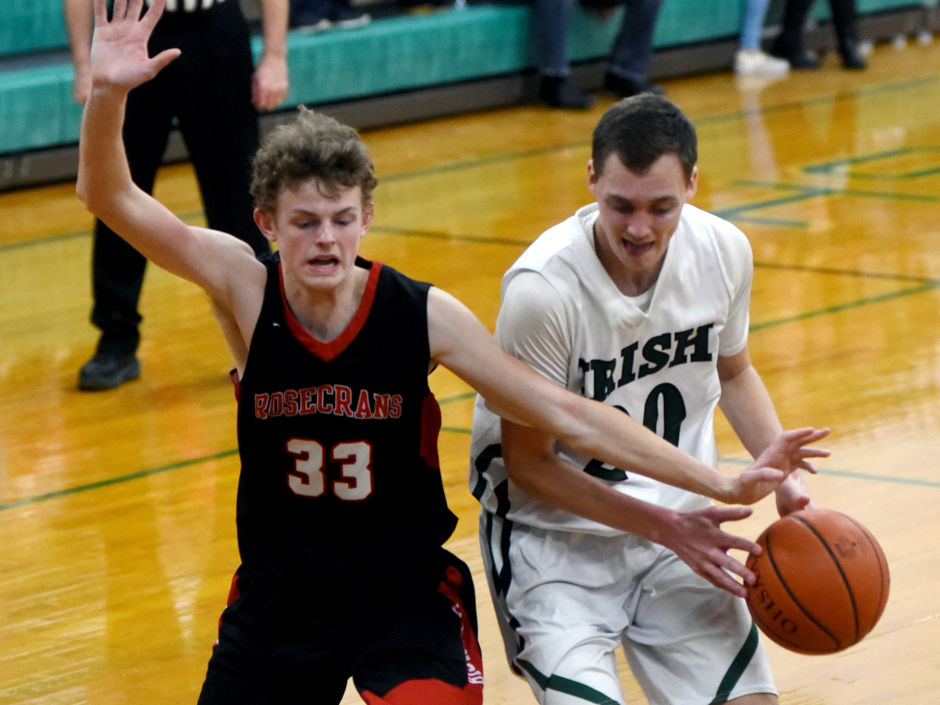 Kaid Brown, of Rosecrans, tries to steal the ball from Fisher Catholic's Bryson Vogel.