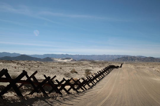 A steel barrier runs along the border of the United States and Mexico on Jan. 26, 2019, near Calexico, Calif.