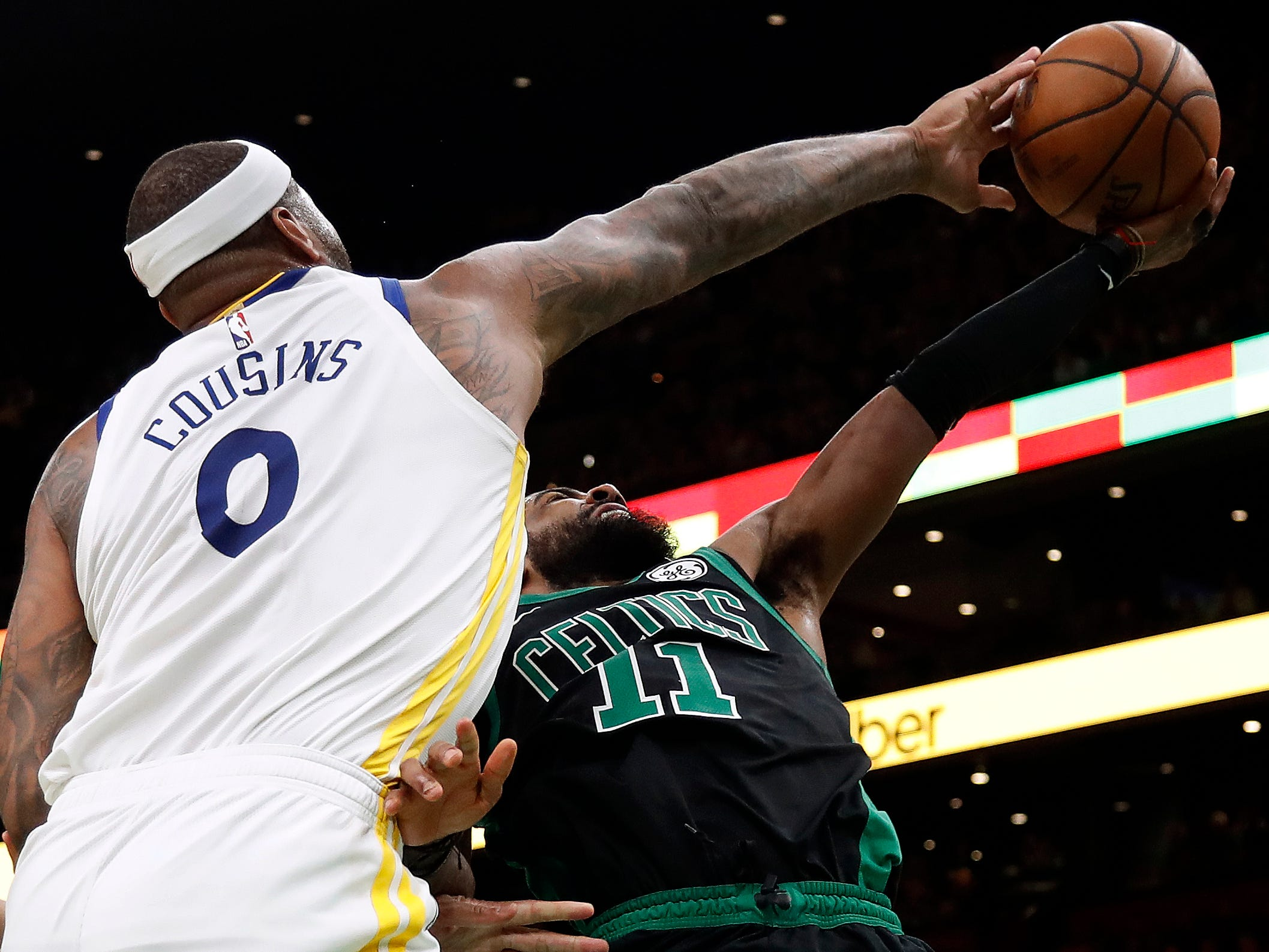 Jan. 26: Warriors center DeMarcus Cousins (0) blocks a shot by Celtics guard Kyrie Irving (11) on a second-half drive to the basket in Boston.