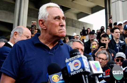 American political consultant Roger Stone speaks to reporters outside the federal courthouse in Fort Lauderdale, Florida, on Jan. 25, 2019.