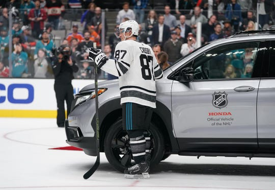 Pittsburgh Penguins star Sidney Crosby won a car as All-Star Game MVP for the victorious Metropolitan Division.