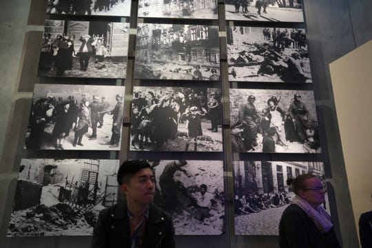 Visitors look at an exhibit at the Yad Vashem Holocaust Memorial Museum in Jerusalem on Jan. 27, 2019, on Holocaust Remembrance Day.