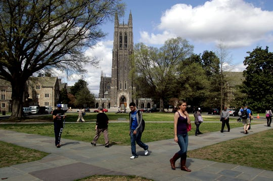 "People walk on the campus of Duke University in Durham, North Carolina, on March 26, 2010. A university official stepped down over the weekend after telling Chinese students to speak ""English 100 percent of the time"" in a leaked email."