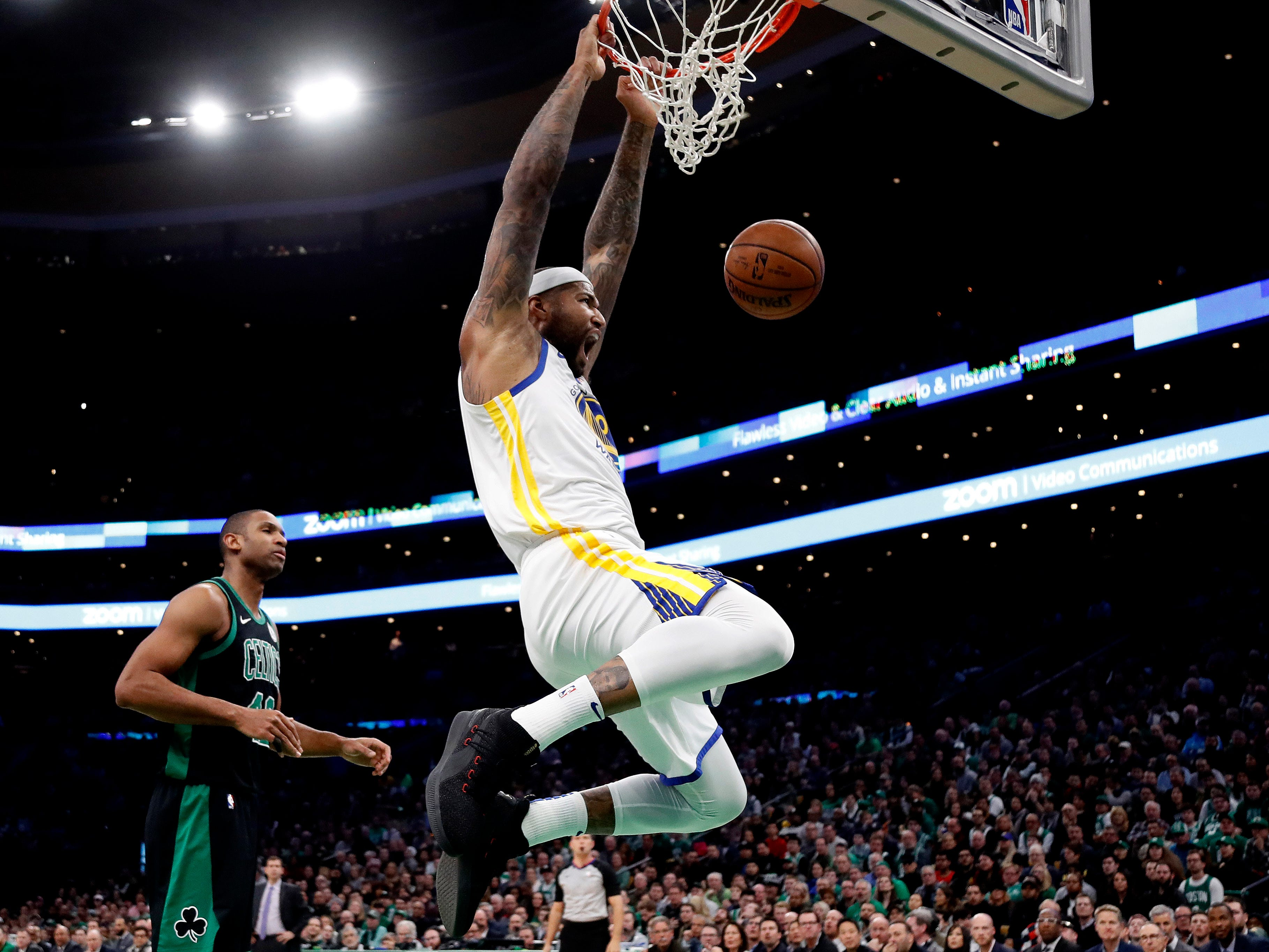 Jan. 26: Warriors center DeMarcus Cousins throws down a thunderous two-handed slam against the Celtics.