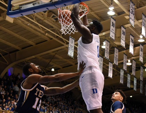 Zion Williamson (1) dunks over Georgia Tech guard Curtis Haywood II (13)  during the second half at Cameron Indoor Stadium.