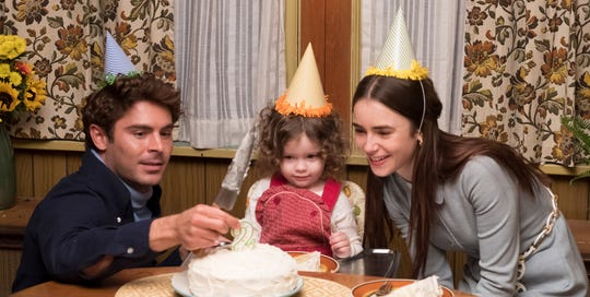 "Ted (Zac Efron, left) and Liz (Lily Collins) celebrate as her daughter turns 2 in crime drama ""Extremely Wicked, Shockingly Evil and Vile."""