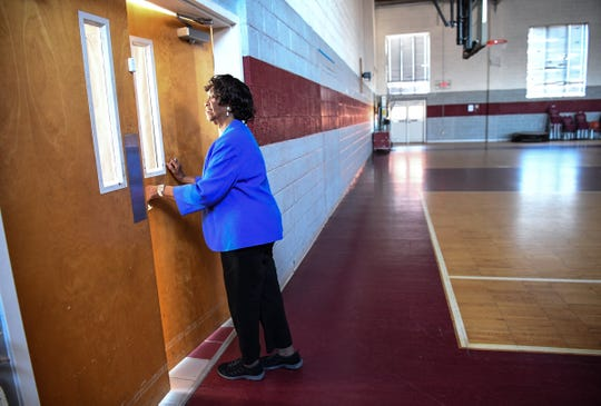 Beatrice Thompson, executive director of the Westside Community Center, recalls when the gymnasium was renovated as she walks around and visits people at the center.