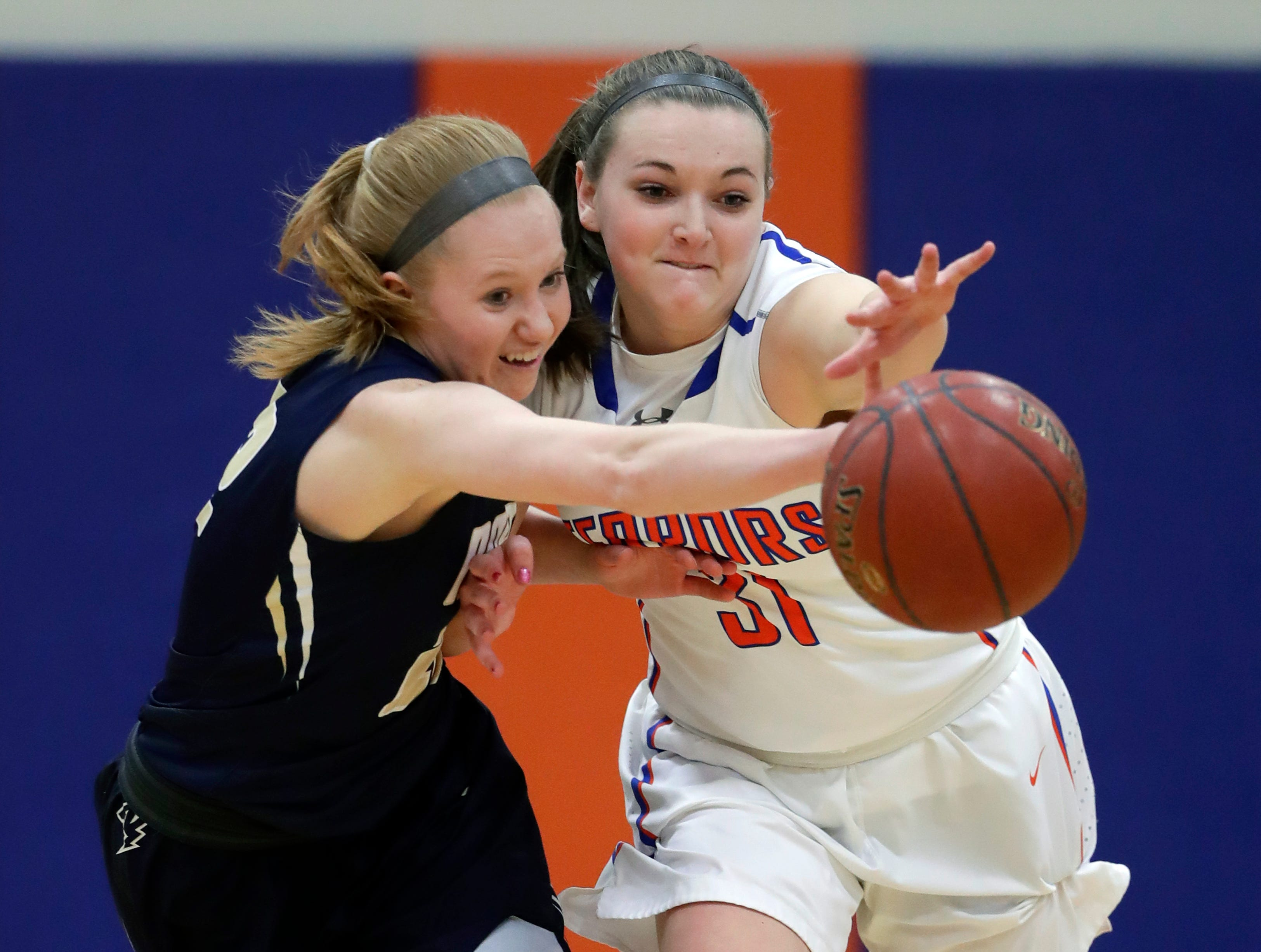 Appleton North High School's Kayla Schroeder, left, battles for a loose ball against Appleton West High School's Christy Fortune during their girls basketball game Friday, January 25, 2019, at Appleton West High School in Appleton, Wis. 