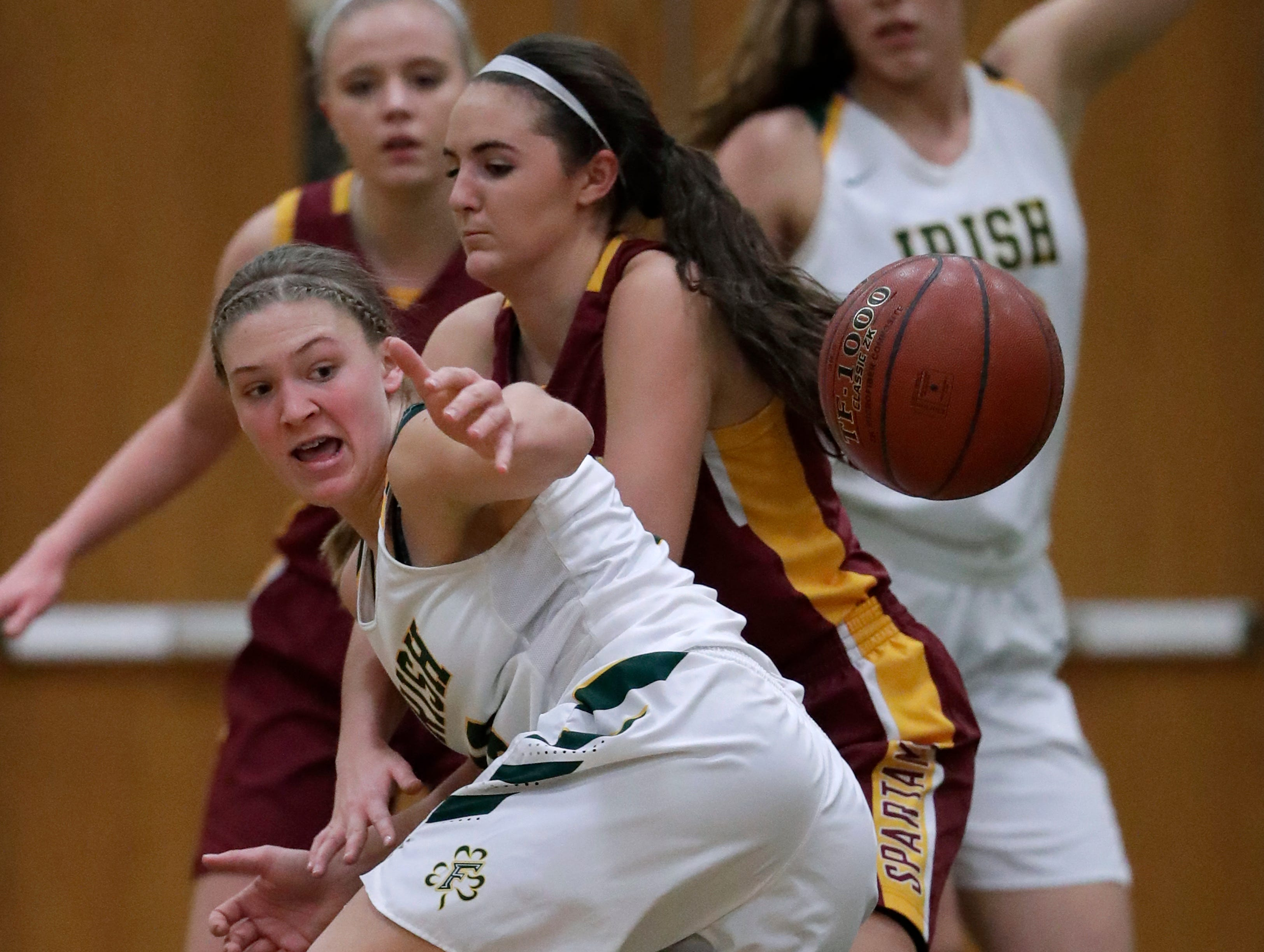 Freedom High School's Gabby Johnson, left, has the ball knocked away by Luxemburg-Casco High School's Cassie Schiltz during their girls basketball game Thursday, January 24, 2019, in Freedom, Wis. 