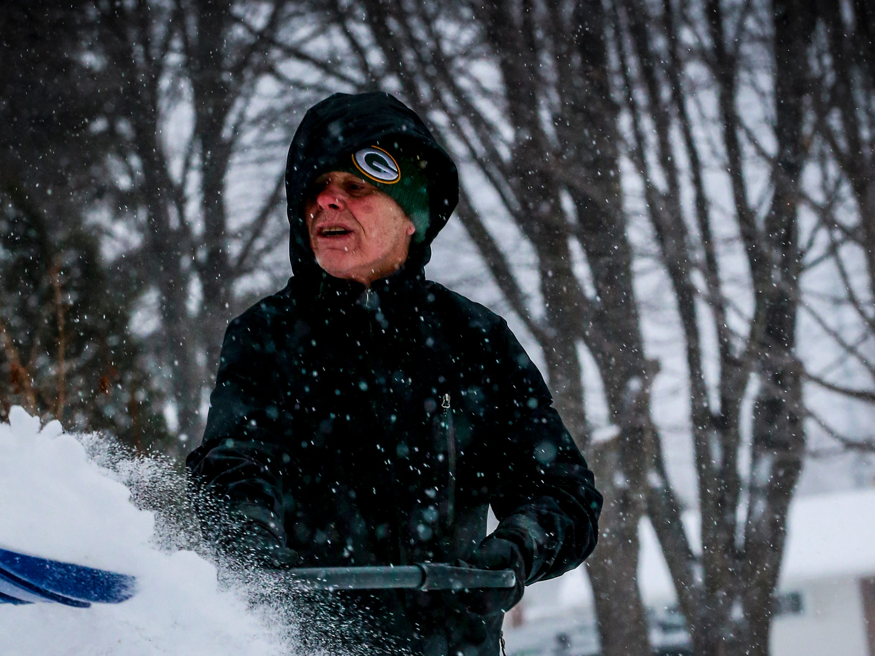 Jeff Martinson works to clear snow on his driveway after a snowstorm Monday, Jan. 28, 2019, in Wausau, Wis.