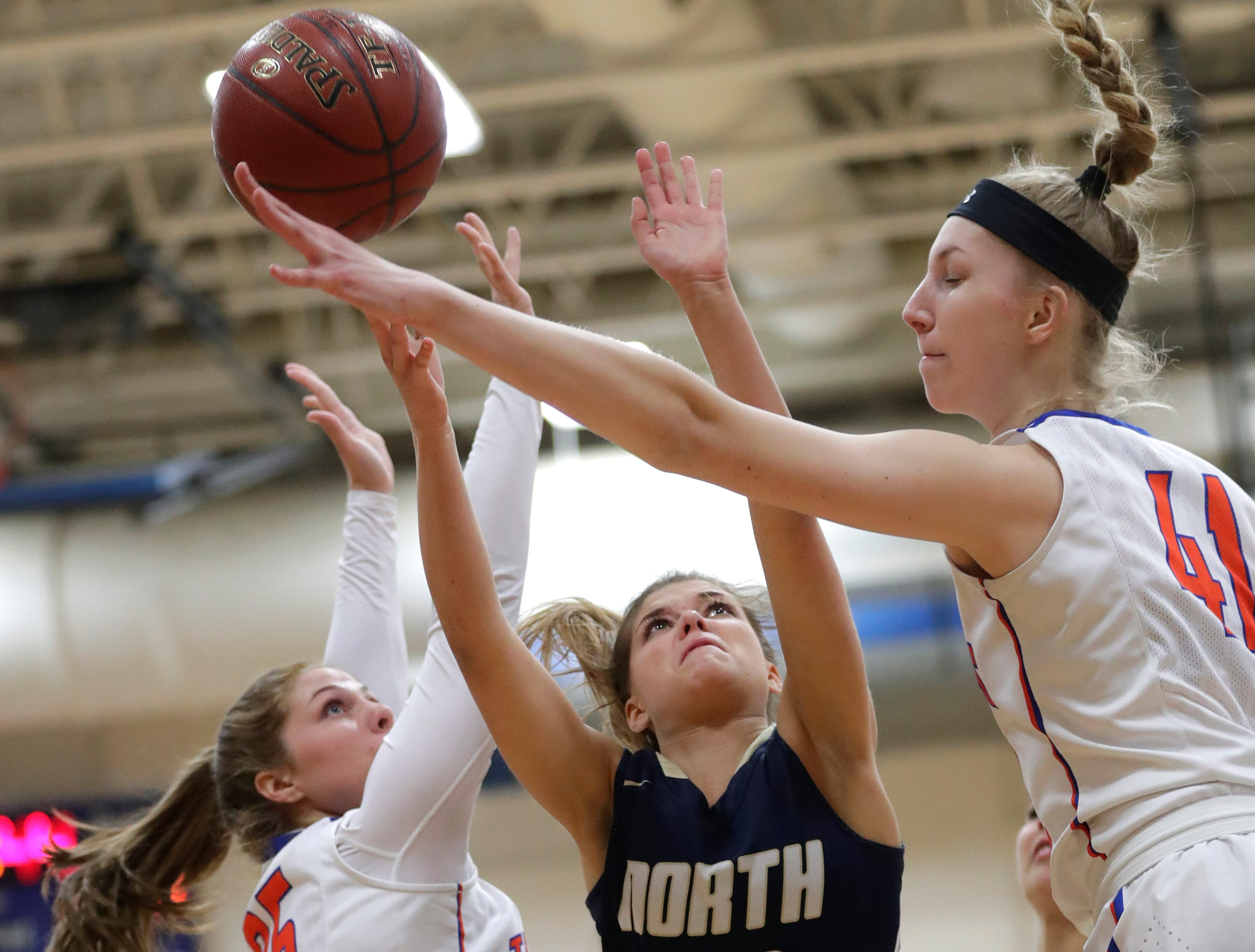 Appleton West High School's Sydney Gehl (35) and Taylor Lauterbach (41) defend against Appleton North High School's Anna Laux (10) during their girls basketball game Friday, January 25, 2019, at Appleton West High School in Appleton, Wis. 