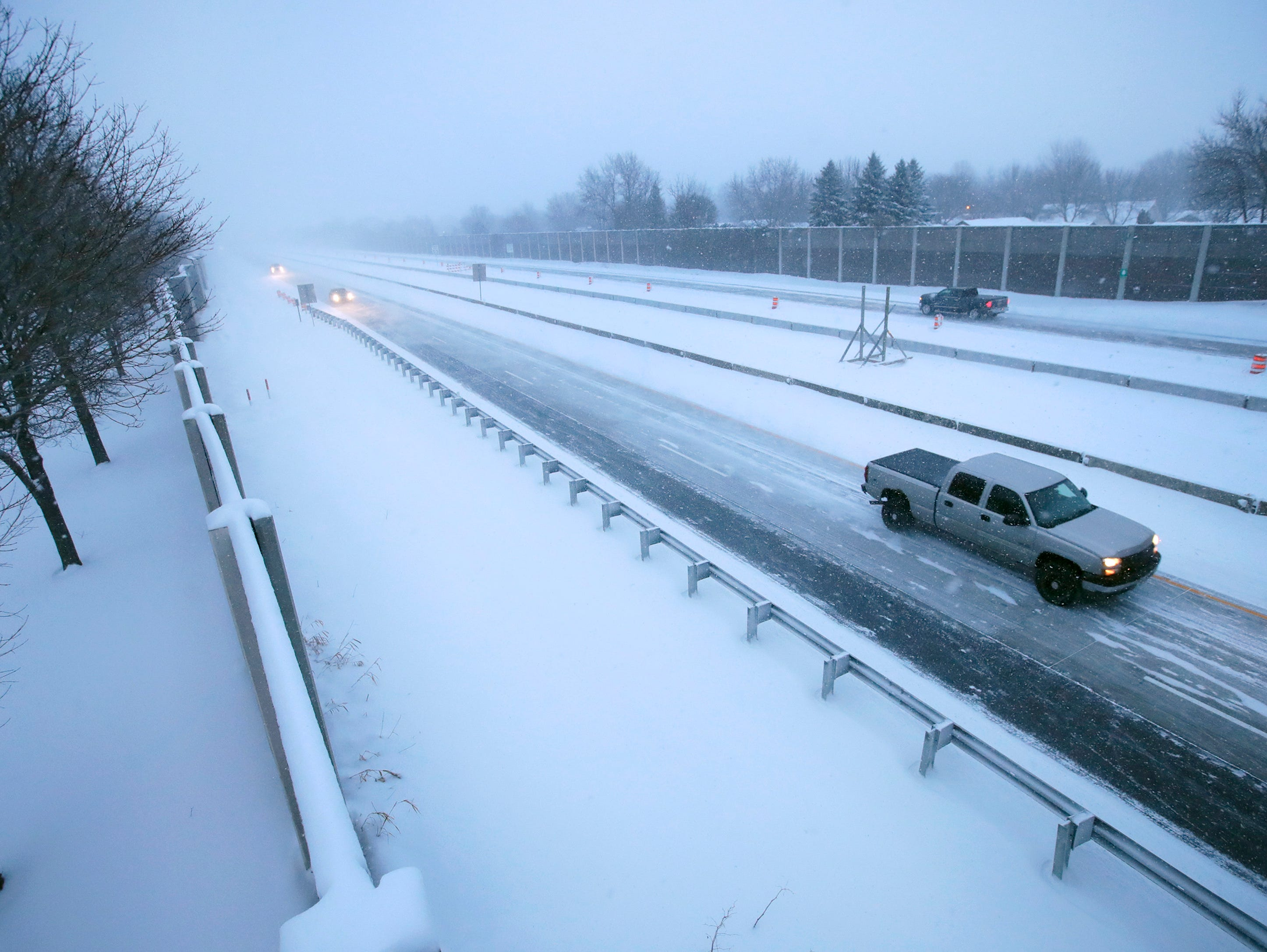 Vehicles travel along 441 during a snowstorm Monday, Jan. 28, 2019, in Appleton, Wis.