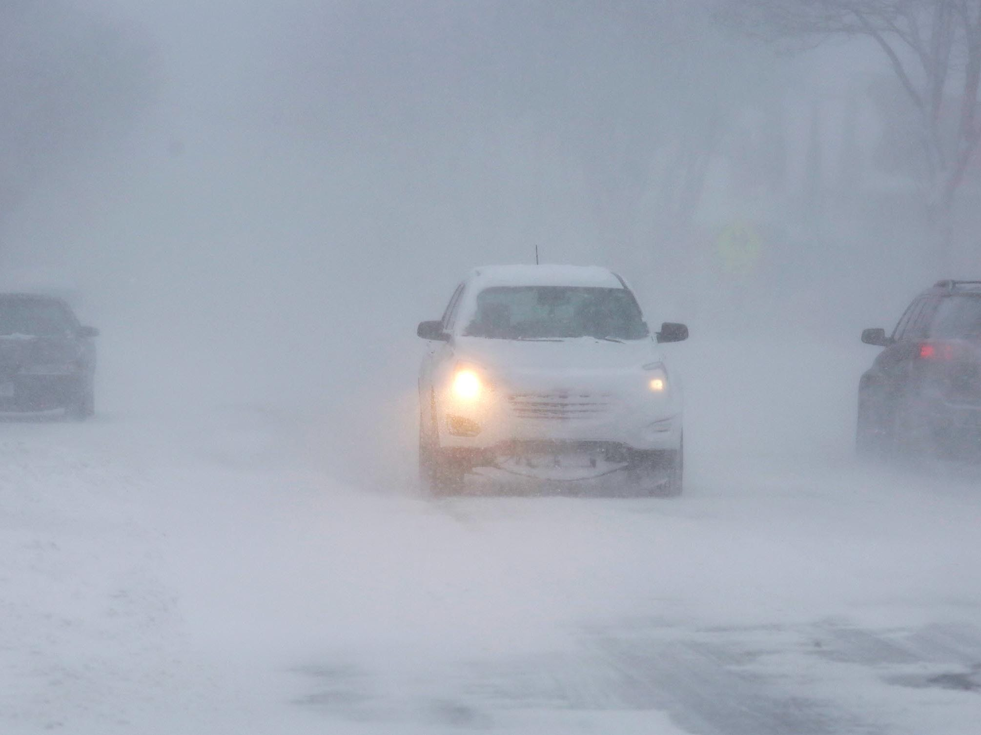 Traffic travels southbound on South 8th Street in near whiteout conditions, Monday, Jan. 28, 2019, in Sheboygan, Wis.