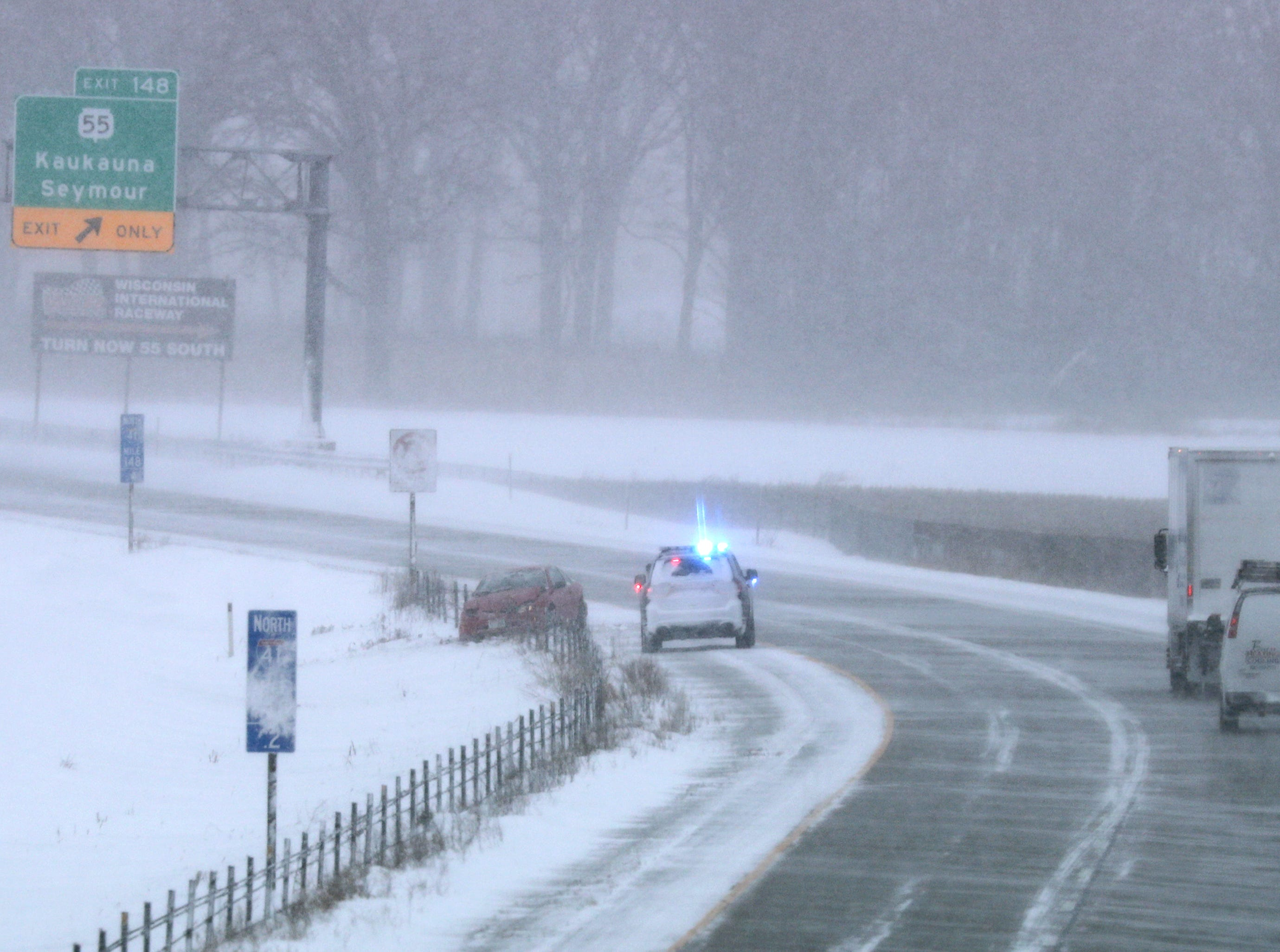 A vehicle in the ditch along northbound U.S. 41 as a winter storm moves through Wisconsin on Monday, Jan. 28, 2019, in Kaukauna, Wis.